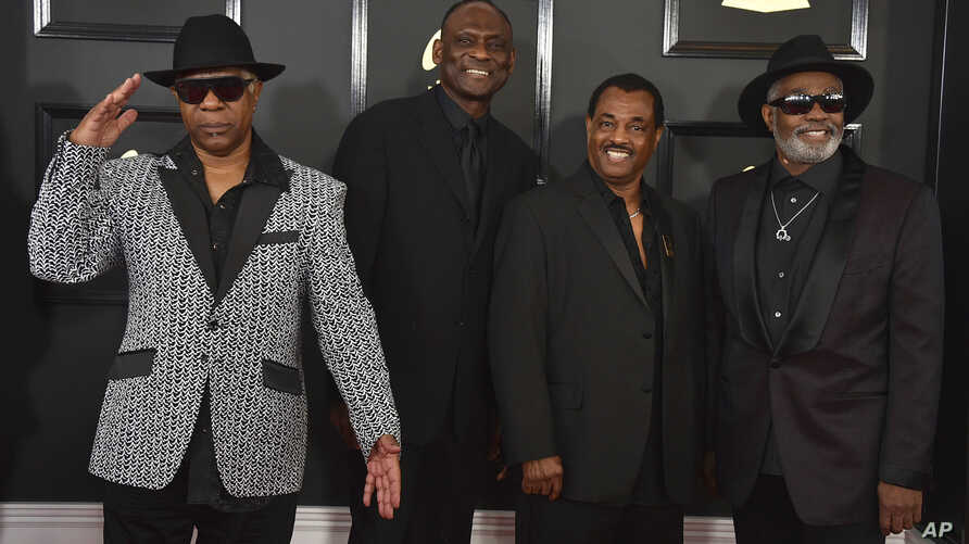 Dennis D.T. Thomas, from left, George Brown, Robert Bell, and Ronald Bell, of the musical group Kool & The Gang, arrive at the 59th annual Grammy Awards at the Staples Center, in Los Angeles, Feb. 12, 2017.