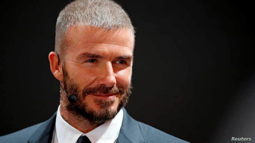 David Beckham visits the VinFast stand during the first press day of the Paris auto show, in Paris, France, Oct. 2, 2018.