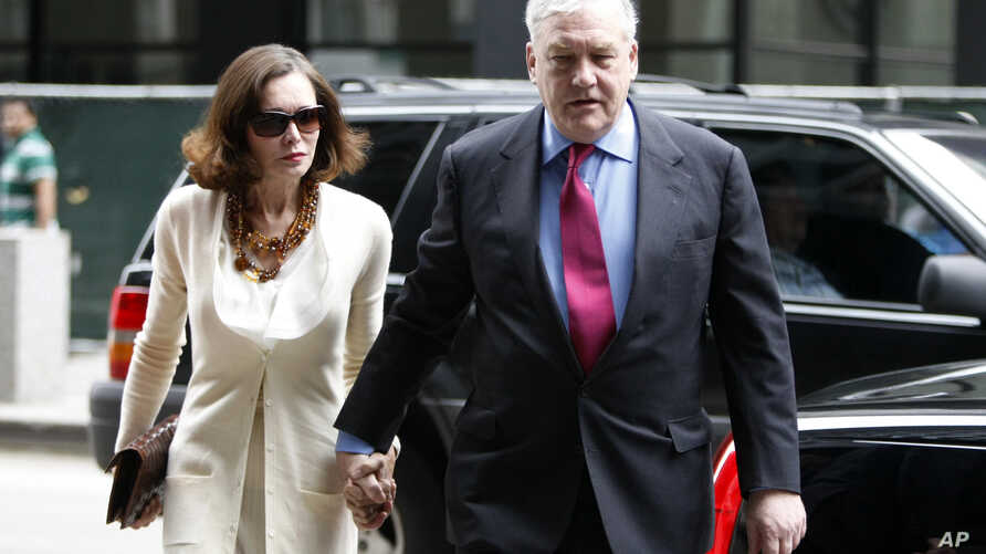 Conrad Black arrives at Federal Courthouse with his wife Barbara Amiel,  Friday, June 24, 2011 in Chicago.