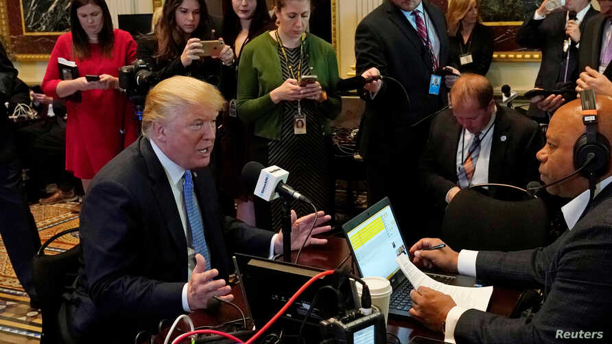 U.S. President Donald Trump speaks during a radio interview on tax reform at the White House in Washington, Oct. 17, 2017.