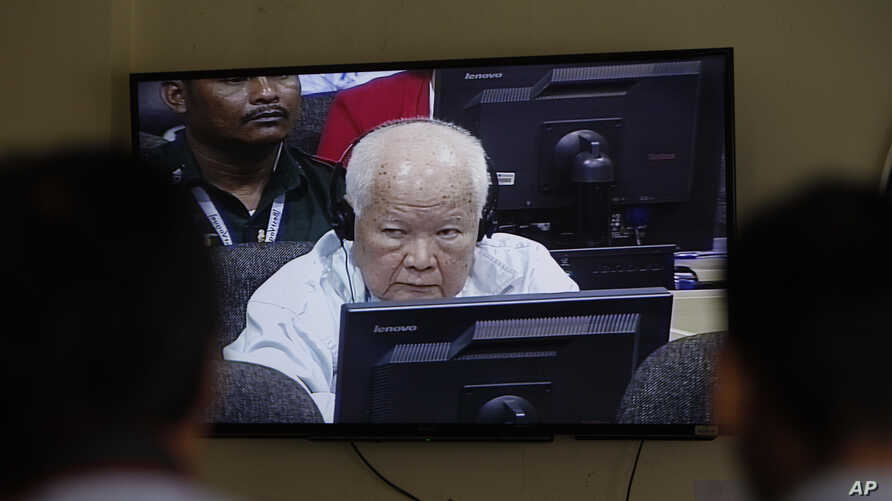 FILE - Khieu Samphan, former Khmer Rouge head of state, is seen on screen at the court's press center at the U.N.-backed war crimes tribunal on the outskirts of Phnom Penh, Cambodia, Nov. 16, 2018.