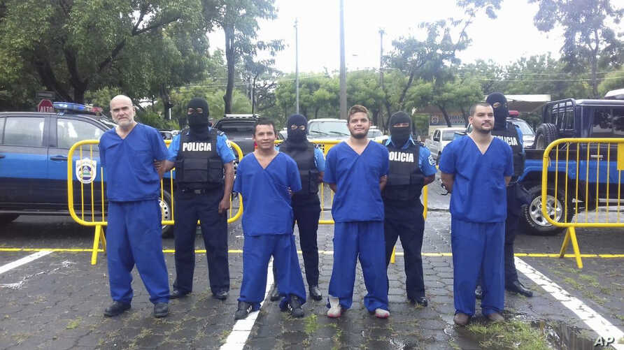 FILE - In this Oct. 17, 2018 photo, provided by the Nicaraguan National Police, prisoners detained and imprisoned during uprisings against the government of President Daniel Ortega, are shown to the press in Managua, Nicaragua.