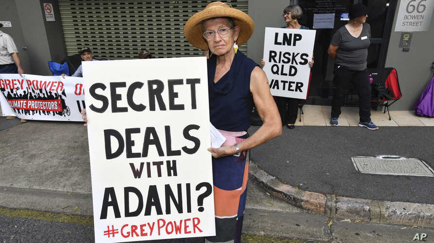 FILE - Anti-Adani coal mine protestor Rae Sheridan is seen outside the LNP (Liberal National Party) headquarters in Brisbane, April 11, 2019. The protestors are trying to stop the building of Adani's Carmichael coal mine.