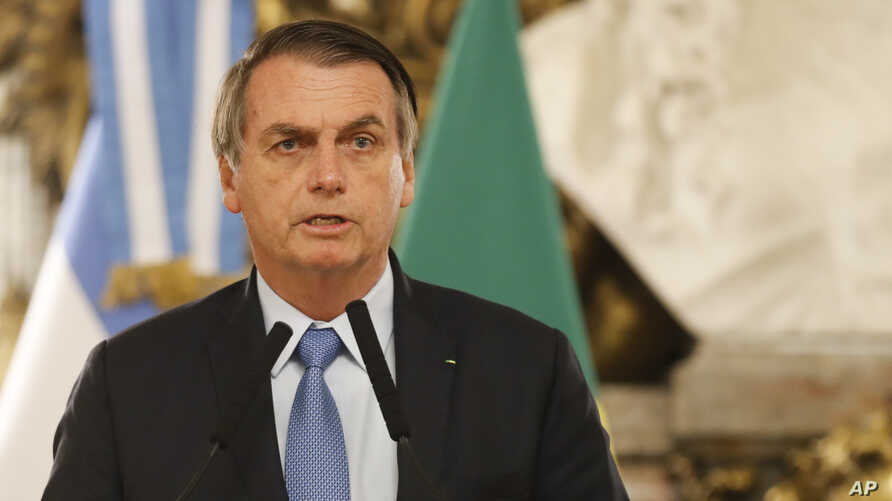 FILE - Brazil's President Jair Bolsonaro talks at the government house in Buenos Aires, Argentina, June 6, 2019.