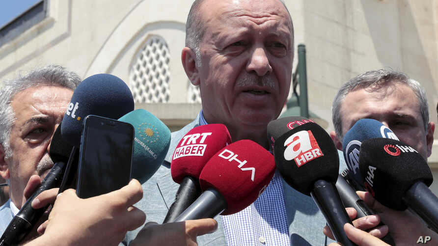 Turkish President Recep Tayyip Erdogan speaks to the media after Friday prayers, in Istanbul, June 7, 2019.