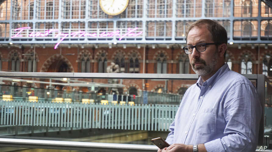 Russia expert Keir Giles, who was targeted in a LinkedIn breach, poses for a portrait during an interview at London's St. Pancras Station, June 4, 2019.