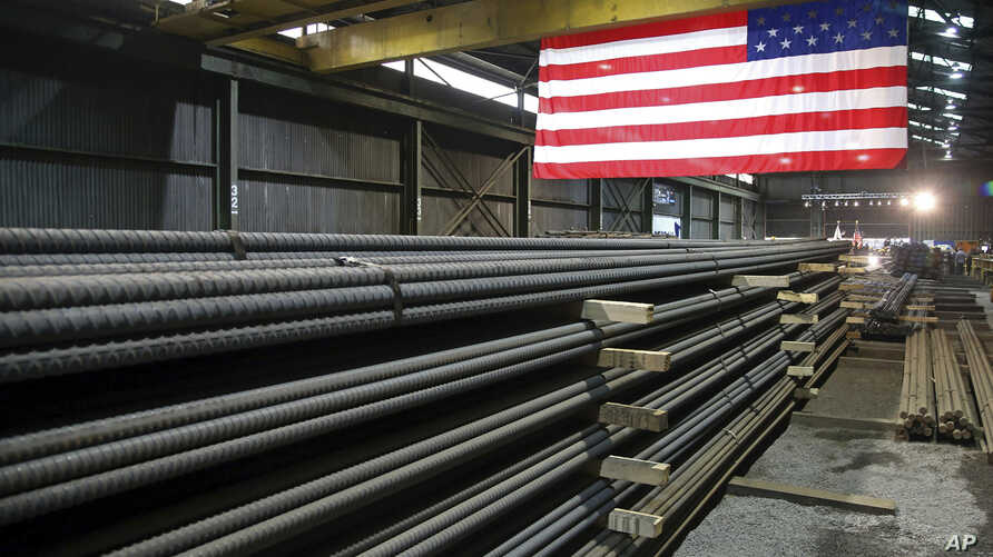 FILE - Steel rods produced at the Gerdau Ameristeel mill in St. Paul, Minn., await shipment, May 9, 2019. The recent flareup with the U.S. over Mexico tariffs may prove to be a pivotal juncture.