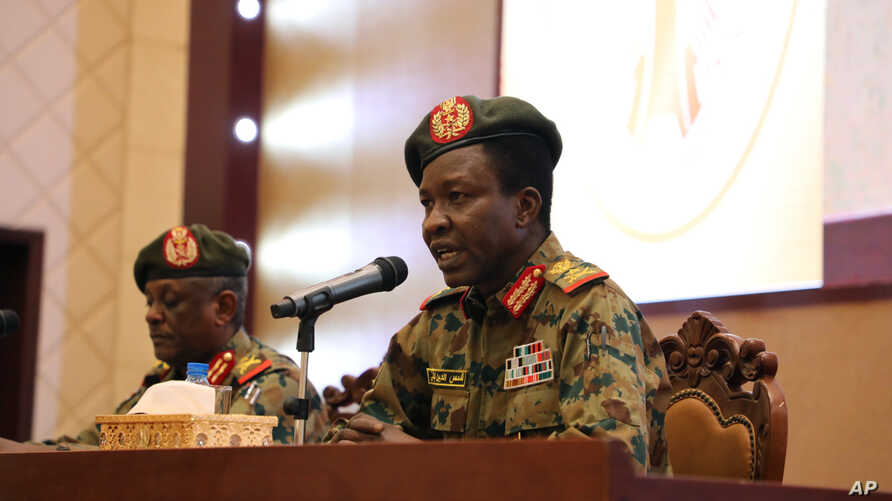 Sudan's ruling Military Council spokesperson Shamseddine Kabbashi makes a speech as he holds a press conference at the Presidential Palace in Khartoum, Sudan, Thursday, June 13, 2019.