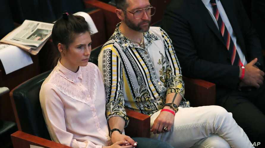 Amanda Knox holds hands with her fiancee Christopher Robinson as they attend a conference during a Criminal Justice Festival at the University of Modena, Italy, June 14, 2019.