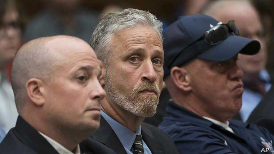 FILE - Entertainer and activist Jon Stewart (C) lends his support to firefighters, first responders and survivors of the Sept. 11 terror attacks at a hearing by the House Judiciary Committee on Capitol Hill in Washington, June 11, 2019.