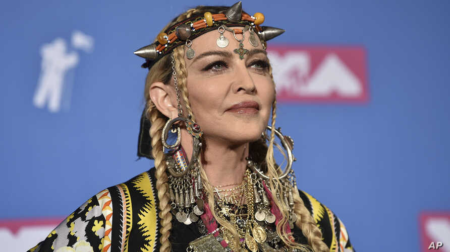 Madonna poses in the press room at the MTV Video Music Awards at Radio City Music Hall, Aug. 20, 2018, in New York.