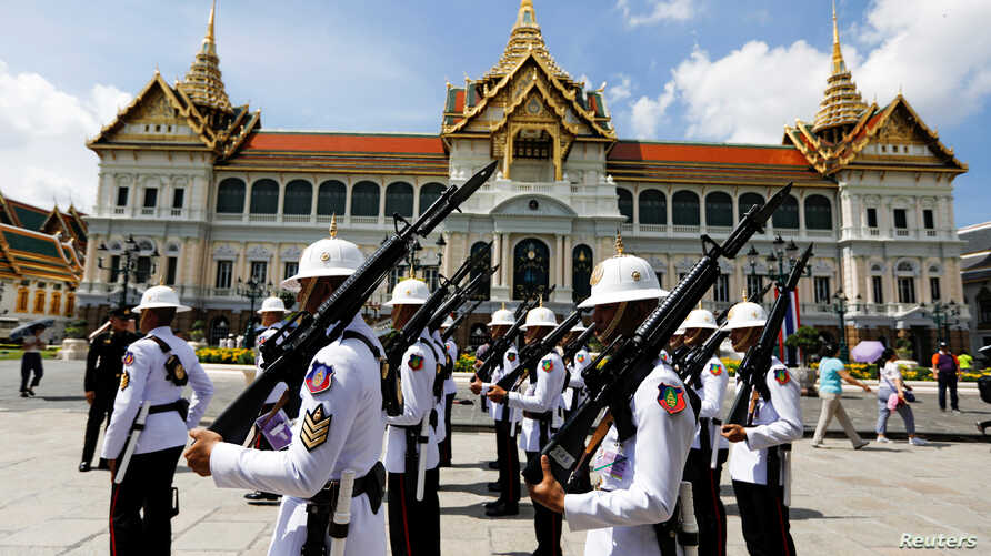 Soldiers are seen during a changing of the guard inside the Grand Palace days before the King's coronation in Bangkok, Thailand Apr. 30, 2019.