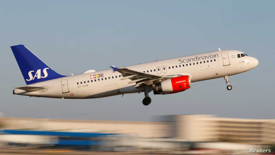 FILE - A Scandanavian Airlines, known as SAS, Airbus A320-200 airplane takes off from the airport in Palma de Mallorca, Spain.
