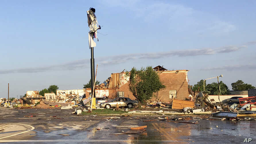 Debris lies on the ground at a motel after a deadly storm moved though the area in El Reno, Okla., Sunday, May 26, 2019.