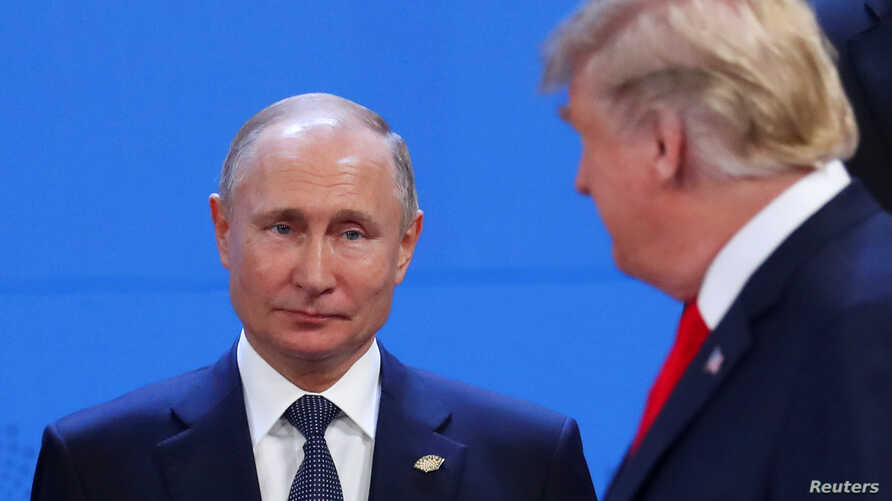 U.S. President Donald Trump and Russia's President Vladimir Putin are seen during the G20 leaders summit in Buenos Aires, Argentina Nov. 30, 2018.