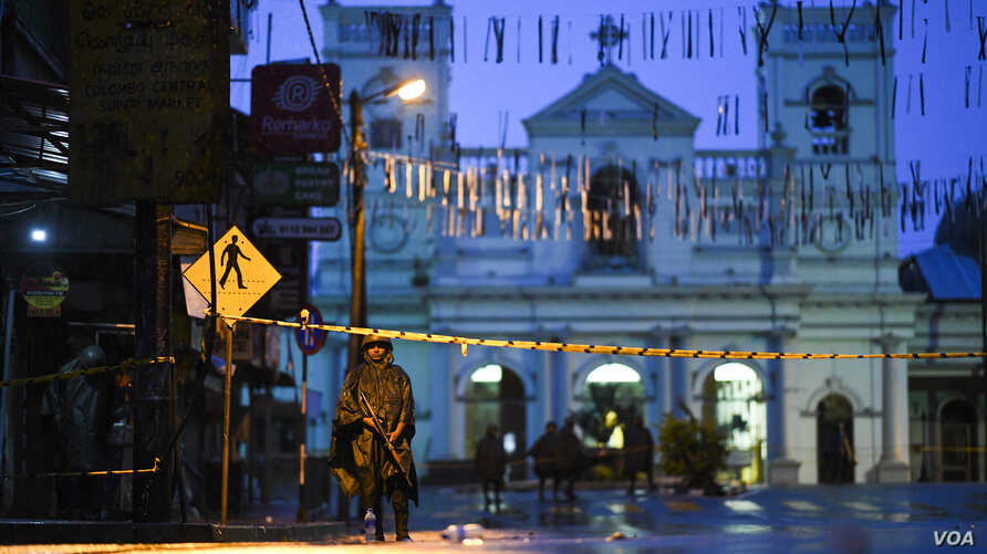 Sri Lankan soldiers stand guard in the rain at St. Anthony's Shrine in Colombo, April 25, 2019. Sri Lanka's Catholic church suspended all public services over security fears, and authorities urged Muslims to pray at home Friday rather than attend a ...