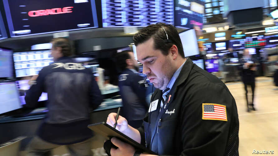Traders work on the floor at the New York Stock Exchange (NYSE) in New York, April 23, 2019.