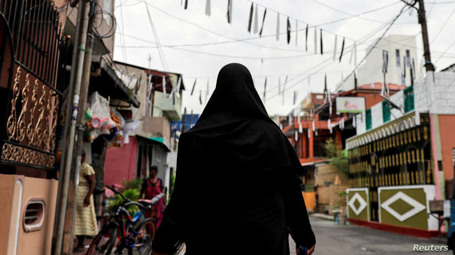 A Muslim woman wearing a hijab walks through a street near St Anthony's Shrine, days after a string of suicide bomb attacks across the island on Easter Sunday, in Colombo, Sri Lanka, April 29, 2019.