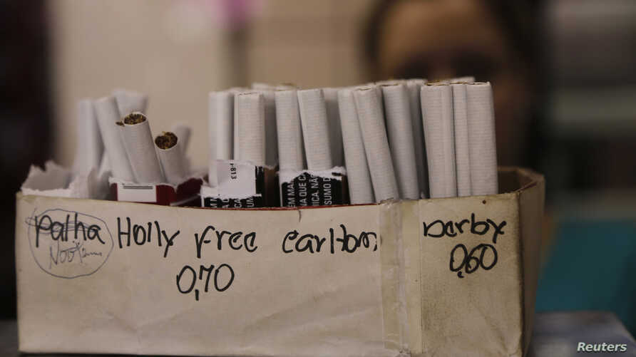 FILE - Cigarettes that are sold per piece are seen in a shop in Belo Horizonte, Brazil.