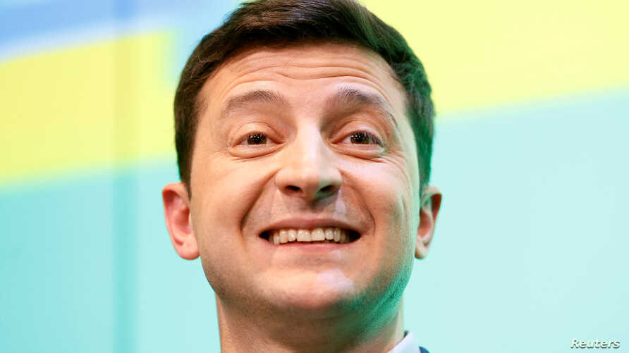 Ukrainian presidential candidate Volodymyr Zelenskiy reacts during a news conference at his campaign headquarters following a presidential election in Kyiv, April 21, 2019.