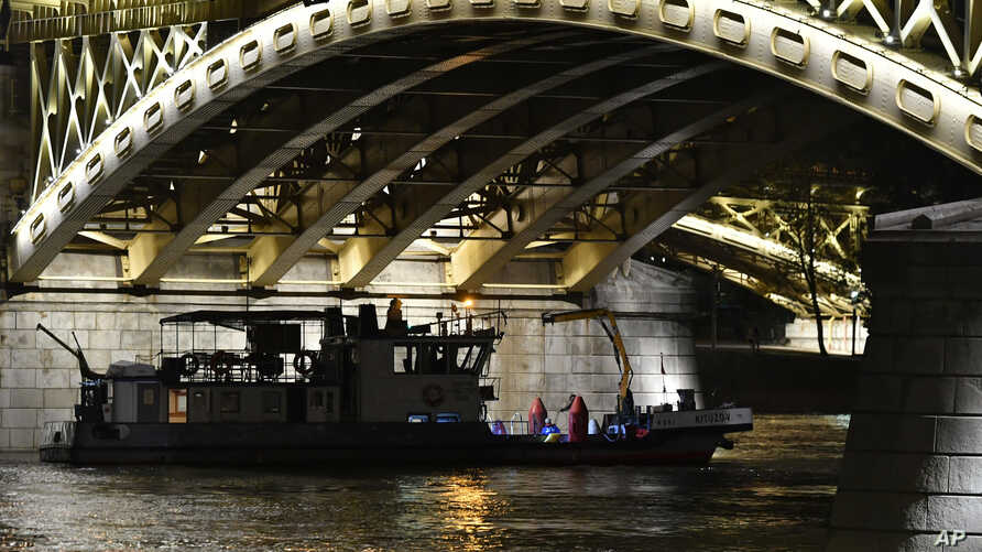 A boat taking part in the rescue operations is anchored under Margaret Bridge in Budapest, Hungary, June 5, 2019.