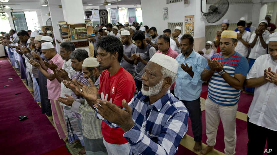 Muslim men pray at a mosque in Colombo, Sri Lanka, April 26, 2019.
