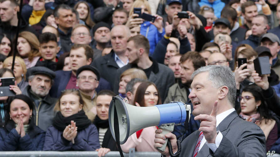 Ukrainian President Petro Poroshenko gestures while speaking to a crowd ahead of the presidential elections on  upcoming April 21, at the Olympic stadium in Kiev, April 14, 2019.