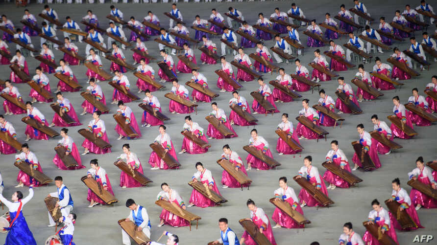 """A photo taken on June 4, 2019 shows musicians during a 'Grand Mass Gymnastics and Artistic Performance', or mass games, at the May Day stadium in Pyongyang. - The """"Grand Mass Gymnastics and Artistic Performance"""" features enormous numbers of people."""