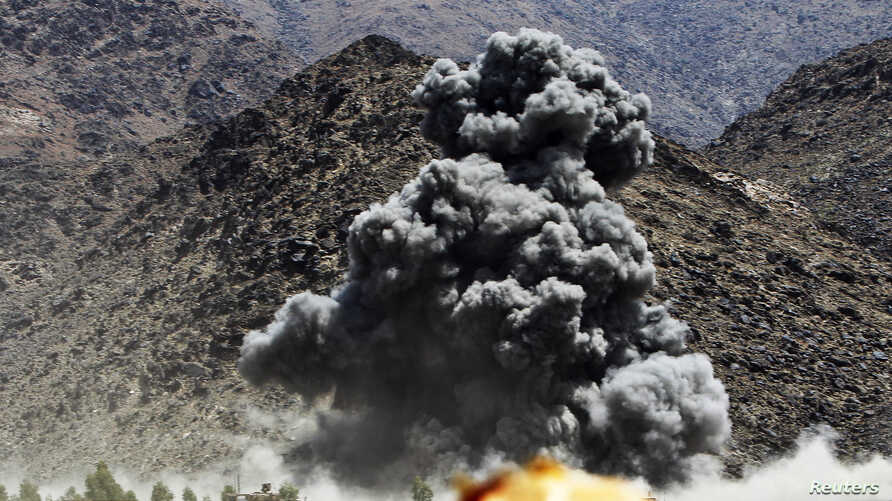 An explosion is seen after airstrikes by NATO-led forces during fighting against Taliban insurgents in...