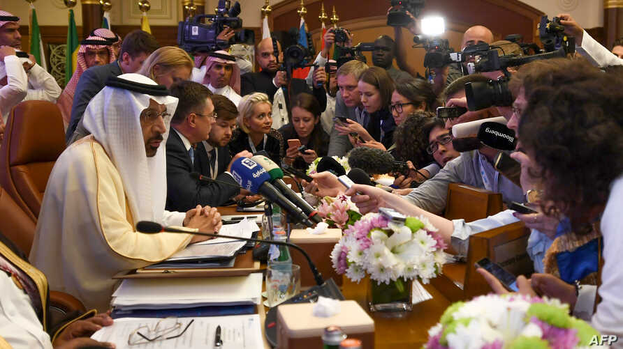 Saudi Energy Minister Khalid al-Falih speaks to the press during the one-day OPEC+ group meeting in the Saudi city of Jeddah, May 19, 2019.