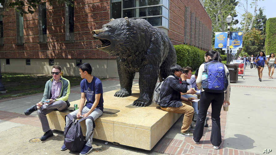 People move about the campus of the University of California, Los Angeles, April 26, 2019. Some students and employees possibly exposed to measles at two Los Angeles universities were still quarantined on campus or told to stay home Friday, but the n...