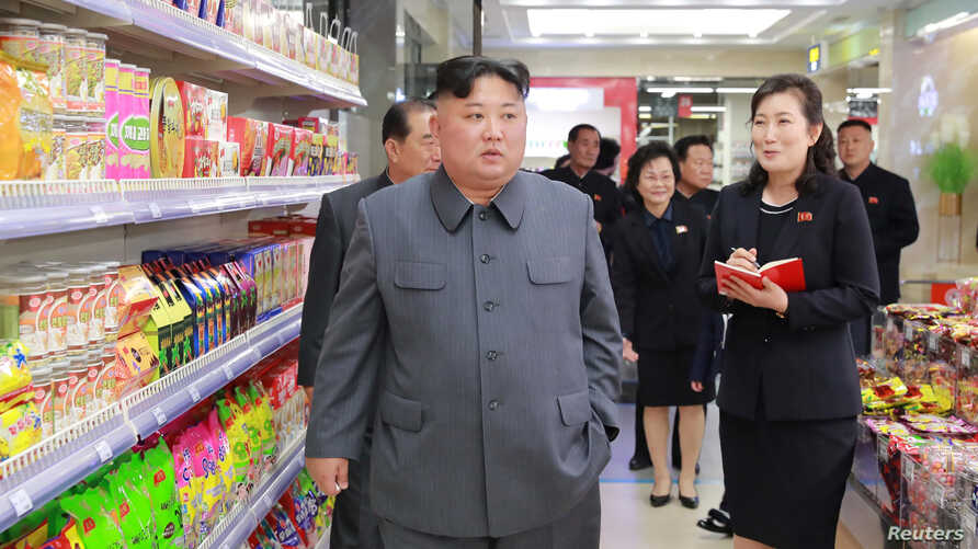 North Korean Leader Kim Jong Un visits Taesong Department Store just before its opening, in this photo released April 8, 2019, by North Korea's Korean Central News Agency.