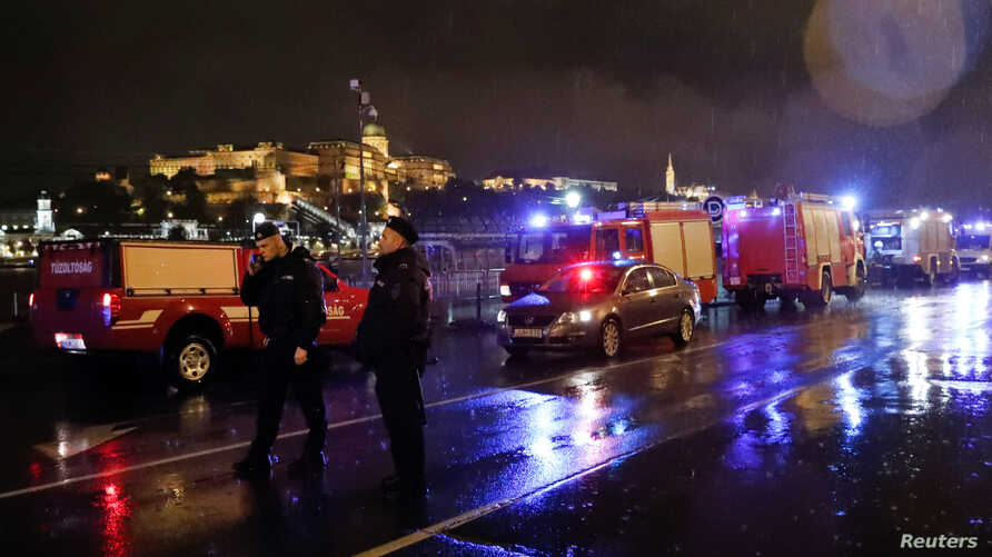Police and fire brigade vehicles are seen on the Danube bank after tourist boat capsized on the riverin Budapest, Hungary, May 29, 2019.