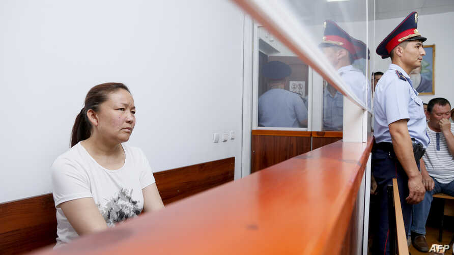 FILE - A picture taken on July 13, 2018 shows Sayragul Sauytbay, an ethnic Kazakh Chinese national and former employee of the Chinese state, who is accused of illegally crossing the border to join her family in Kazakhstan, inside a defendants' cage d...