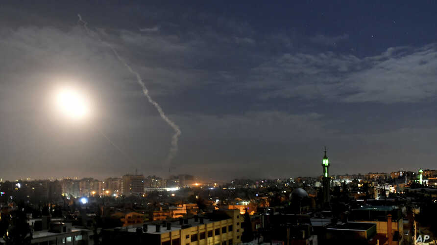 FILE - This SANA news agency photo shows missiles flying near international airport in Damascus, Syria, Jan. 21, 2019. Syrian air defenses targeted projectiles fired from the direction of Israel May 17-18, 2019, Syrian state media said. Israel did...