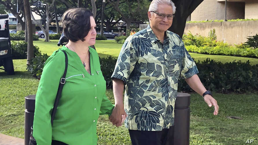 FILE - Retired Honolulu police chief Louis Kealoha and his wife, former deputy city prosecutor Katherine Kealoha, walk to the U.S. district court in Honolulu, Hawaii, March 12, 2019.