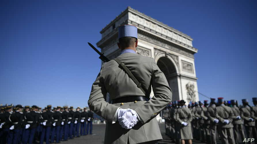 Soldiers of the French Foreign Legion stand before the beginning of the ceremony marking the 73rd anniversary of the victory over Nazi Germany during WWII, May 8, 1945, under the Arc de Triomphe in Paris, May 8, 2018.