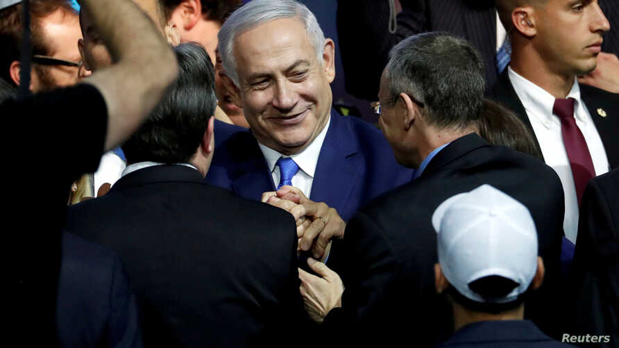 FILE - Israeli Prime Minister Benjamin Netanyahu is greeted by supporters of his Likud party as he arrives to speak following the announcement of exit polls in Israel's parliamentary election at the party headquarters in Tel Aviv, Israel, April 10, 2...