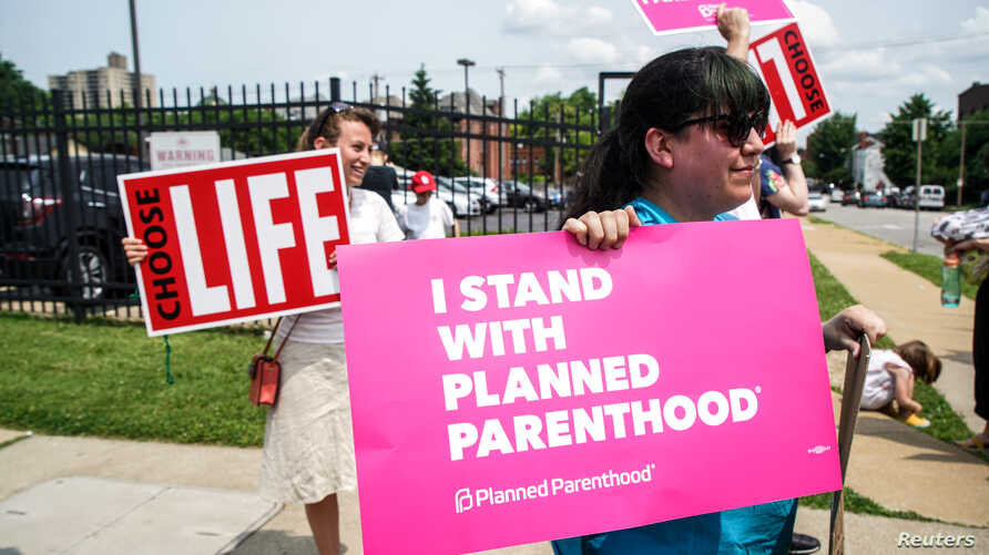 Pro-choice and pro-life protesters stand outside of Planned Parenthood as a deadline looms to renew the license of Missouri's sole remaining Planned Parenthood clinic in St. Louis, Missouri, May 31, 2019.