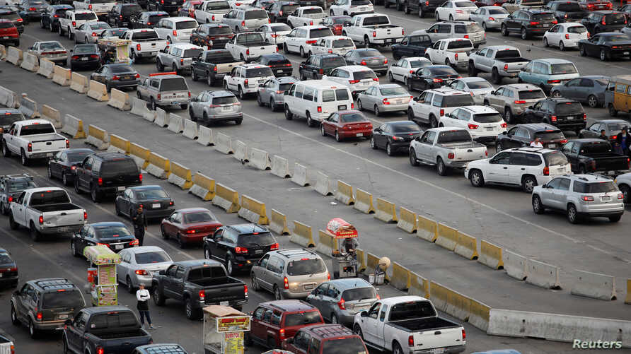 Cars wait to cross at San Ysidro border crossing between the U.S. and Mexico, in Tijuana, Mexico, May 6, 2019. An American man was arrested in a car chase to the crossing that left several people injured.
