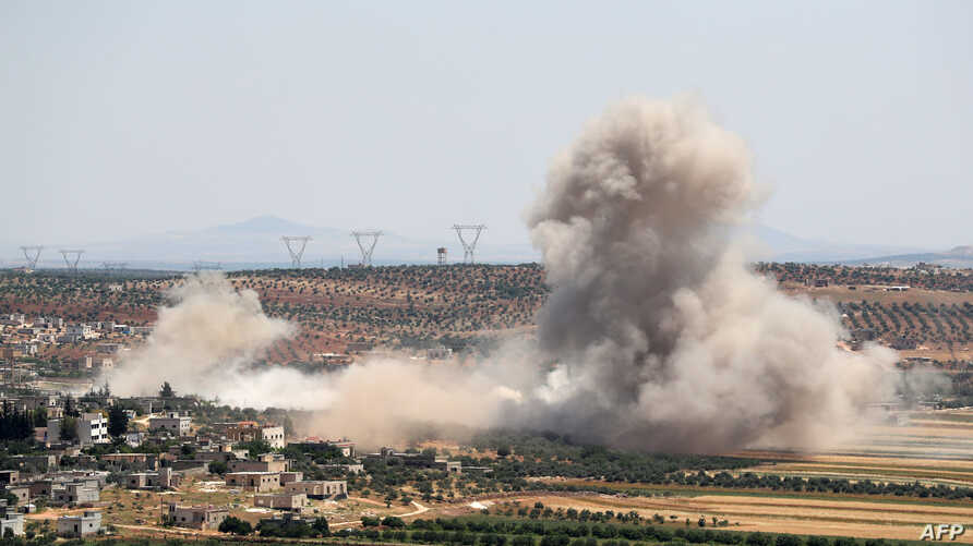 Smoke billows during reported Syrian government forces' bombardments on the village of Sheikh Mustafa in the southern countryside of the jihadist-held Idlib province, May 27, 2019.