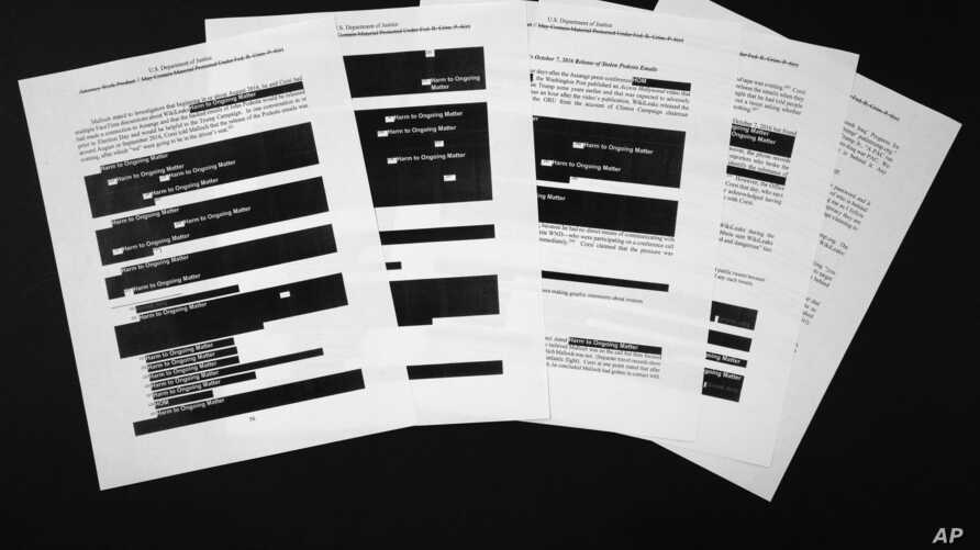 Special counsel Robert Mueller's redacted report on the investigation into Russian interference in the 2016 presidential election is photographed April 18, 2019, in Washington.