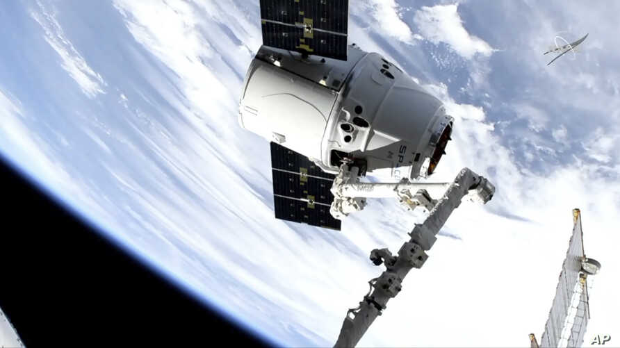 In this image taken from NASA Television, a SpaceX shipment arrives at the International Space Station following a weekend launch,  May 6, 2019.