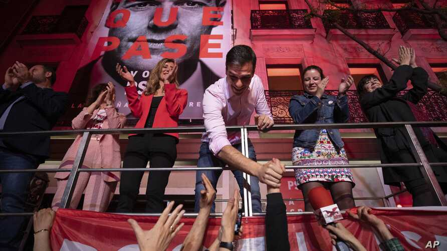 FILE - Spain's Prime Minister and Socialist Party leader Pedro Sanchez shakes hands with supporters outside the party headquarters following the general election in Madrid, Spain, April 28, 2019.
