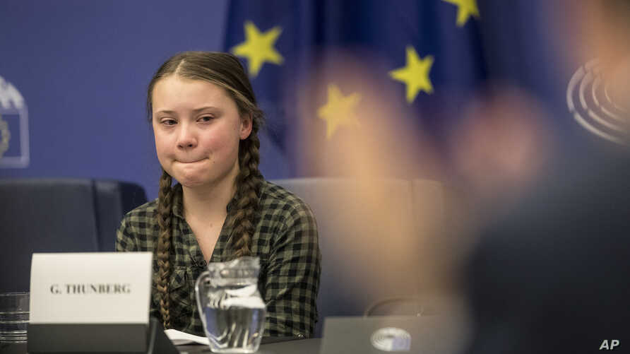 Young Swedish environmental activist Greta Thunberg reacts after giving a speech during a special meeting of the Environment Committee at the European Parliament in Strasbourg, Eastern France, Apr. 16, 2019.