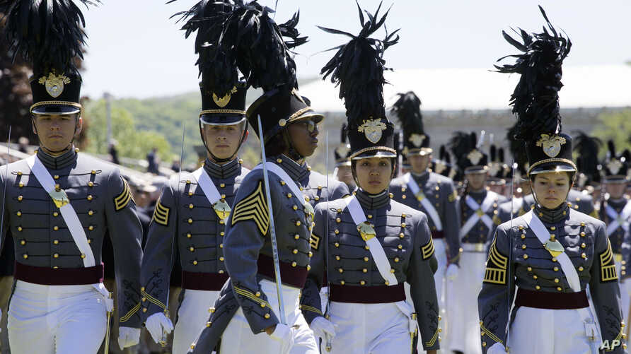 FILE -  Cadet Isabella Minter, center, marches with senior class members during Parade Day at the U.S. Military Academy in West Point, N.Y., May 22, 2019.
