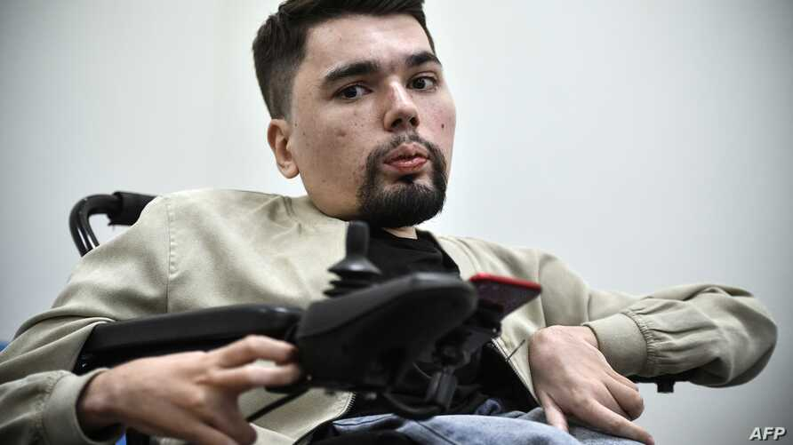 """Alexander Gorbunov, also known as blogger StalinGulag, talks to AFP correspondent during an interview in Moscow, May 3, 2019. The 27-year-old author of StalinGulag skewers """"hypocrisy"""" of Putin's system and the everyday injustices ordinary Russians f..."""