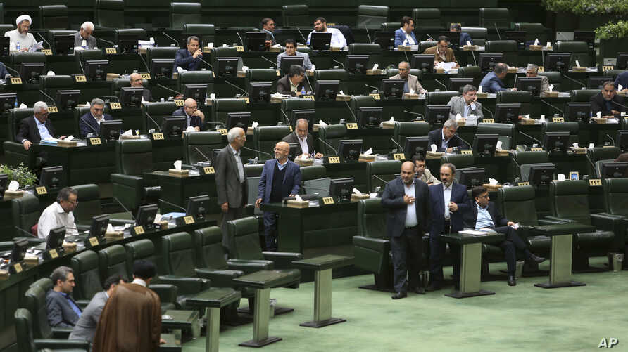 Iranian lawmakers attend a session of parliament in Tehran, Iran, Tuesday, April 16, 2019. Iran's lawmakers overwhelmingly approved a bill labeling U.S. forces in the Middle East as terrorist, a day after the U.S. terrorism designation for Iran's Rev...