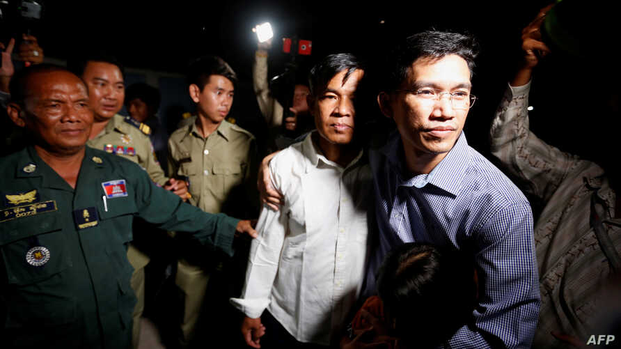 Yeang Sothearin (R) and Uon Chhin, former journalists for U.S. founded Radio Free Asia (RFA), who have been charged with espionage, leave Prey Sar prison after being freed on bail, in Phnom Penh, Cambodia, Aug. 21, 2018.