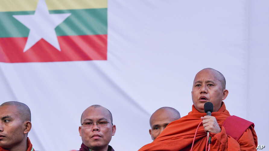 Buddhist monk and anti-Muslim community leader Wirathu, right, speaks during a nationalist rally in Yangon, Myanmar, May 5, 2019.